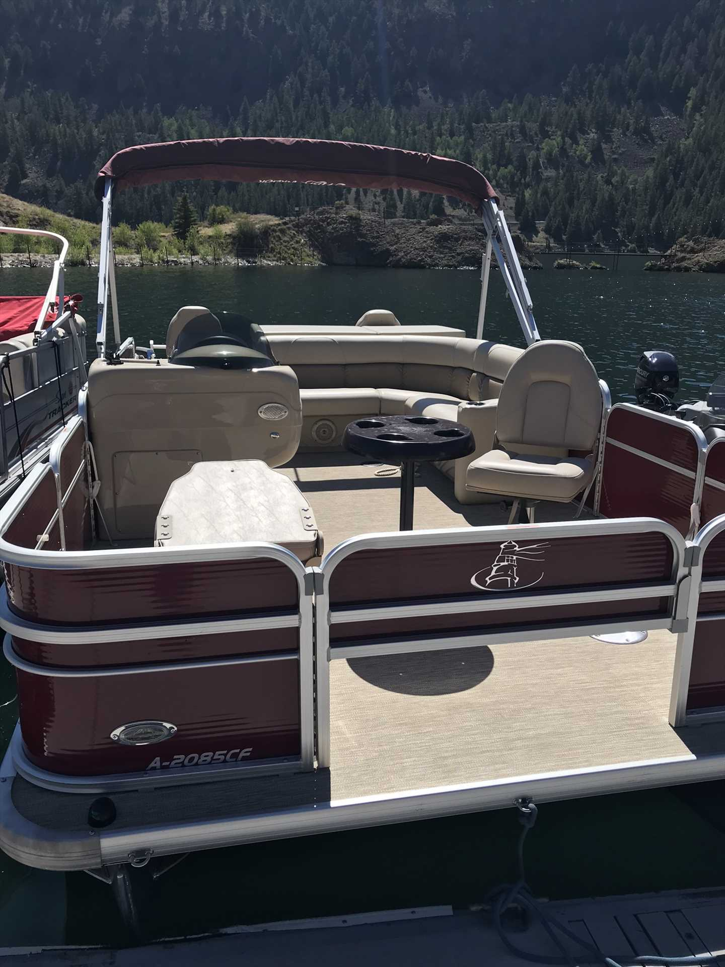 Pontoon Boat that Comes with The Property with a 6 Night Ren