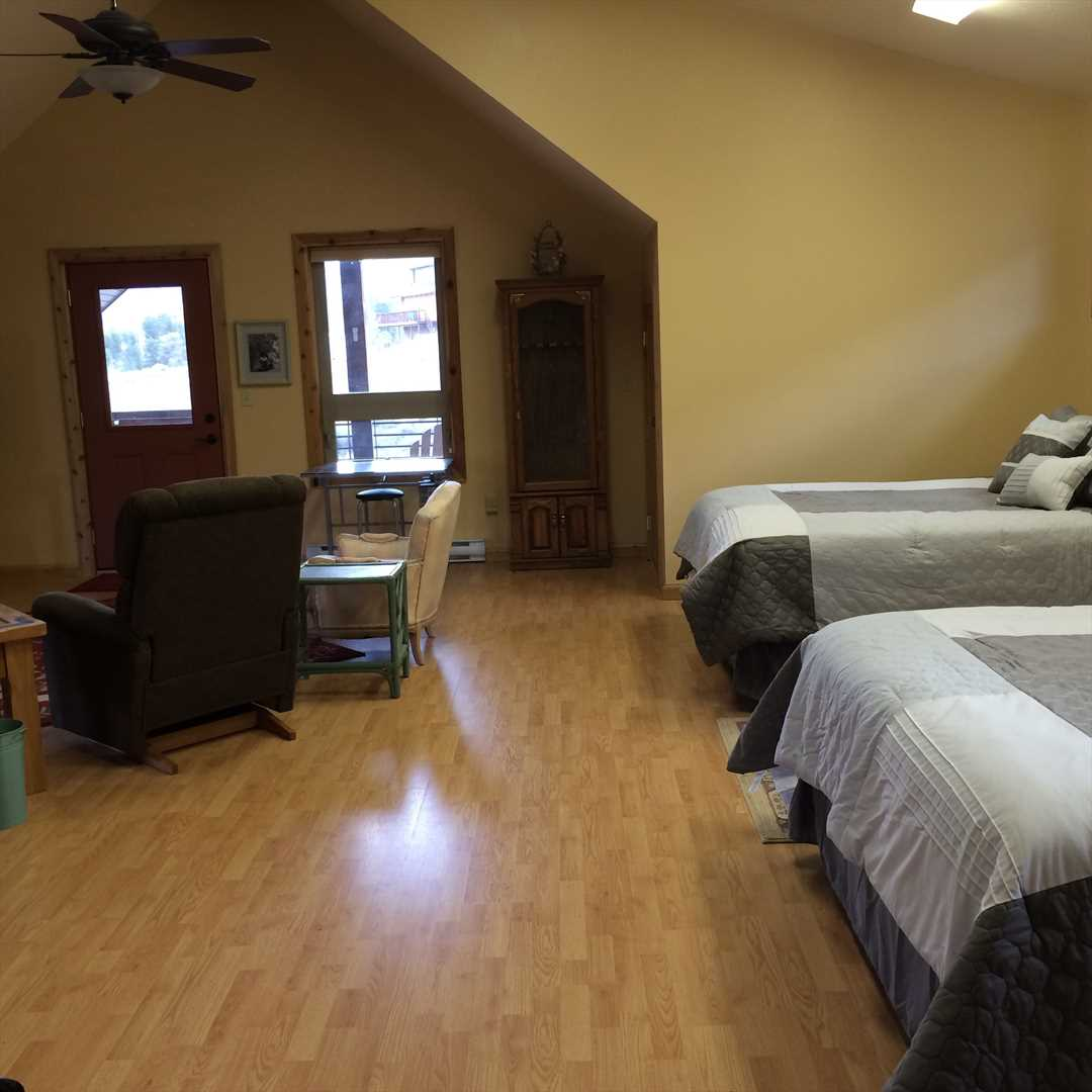 Queen Beds and Living Room