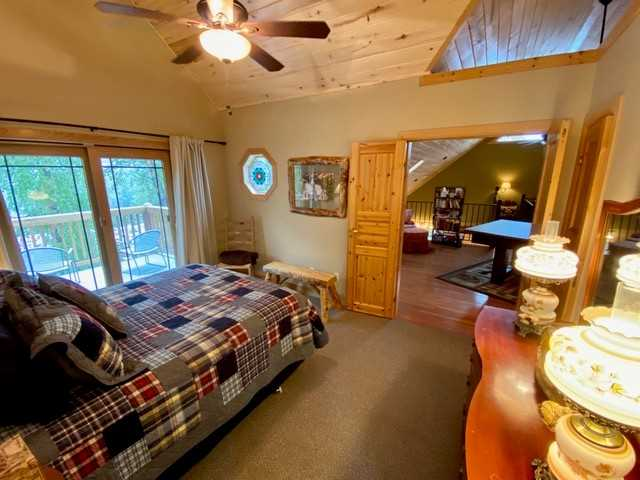 Upstairs Bedroom with Queen Bed and Balcony