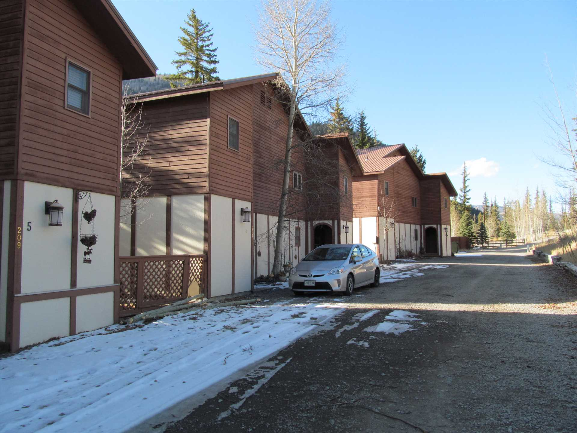 Parking for two cars per townhome.  Trailers can be parked u
