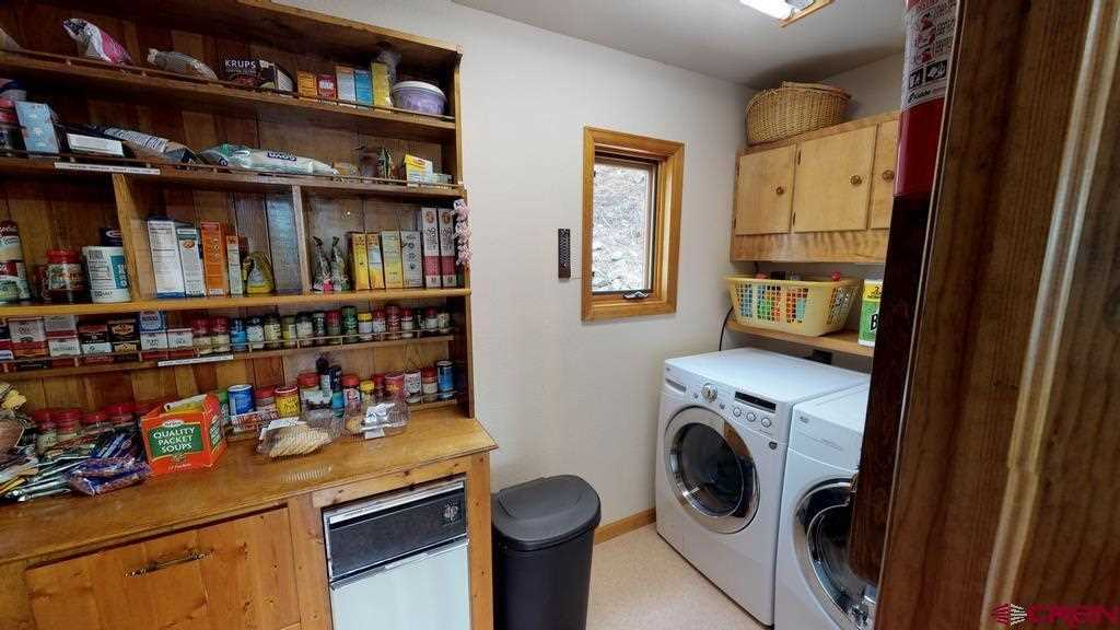 Pantry and Laundry Room Behind Kitchen
